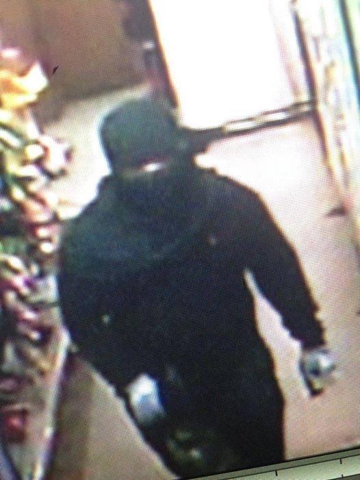 Surveillance video shows 'ninja burglar' in Exxon. (FOX Carolina)