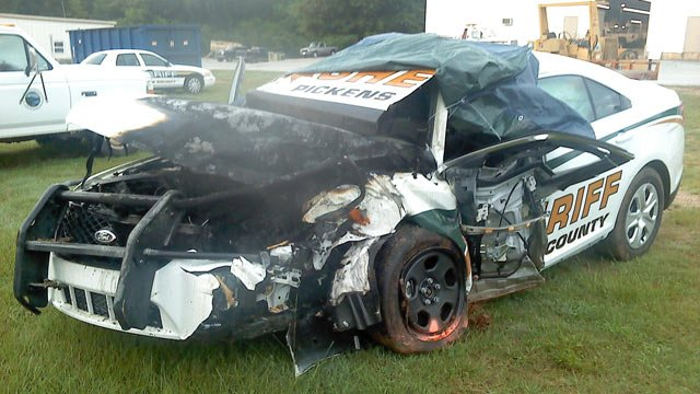 The damaged patrol car considered a complete loss. (Aug. 14, 2014/Pickens Co. Sheriff's Office)