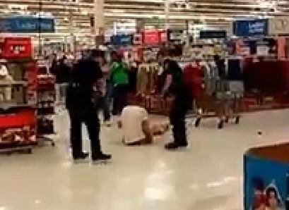 Deputies subdue suspect at Walmart (Courtesy: Facebook)