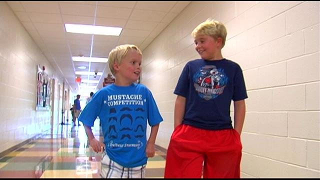 Christopher Browning (L) walks with a classmate. (Aug. 26, 2014/FOX Carolina)
