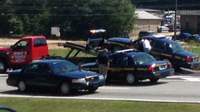 Deputy's car towed away from fatal crash scene on Augusta Road. (Aug. 28, 2014/FOX Carolina)