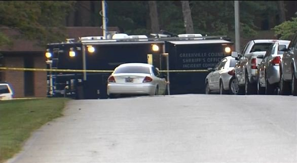 Deputies outside of the Hollingsworth plant on Laurens Road. (Aug. 29, 2014/FOX Carolina)