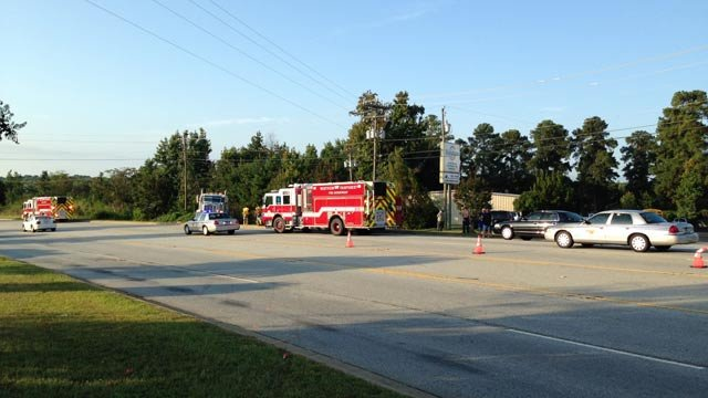 Troopers and firefighters have Southport Road partially blocked due to the crash. (Sept. 3, 2014/FOX Carolina)
