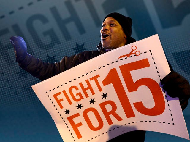 Demonstrator at rally for better wages outside McDonald's restaurant in Chicago. (File/Associated Press)