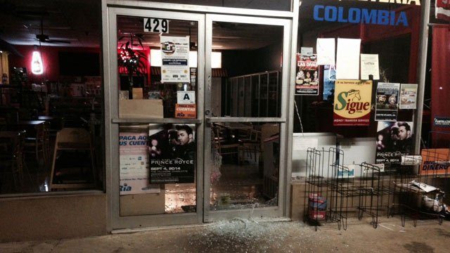 The busted out front door of El Carriel restaurant, located on Main Street in Mauldin. (Sept. 3, 2014/FOX Carolina)
