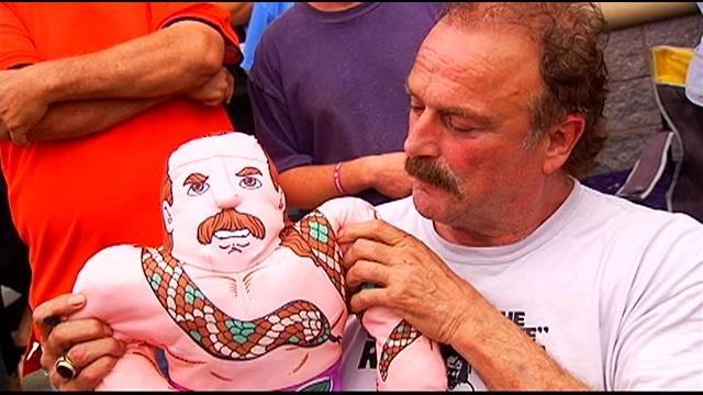 Roberts with a 'Wrestling Buddy' doll in his likeness (FOX Carolina)