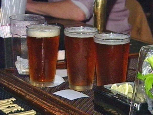 Three pints of a beer sit on a Greenville bar. (File/FOX Carolina)