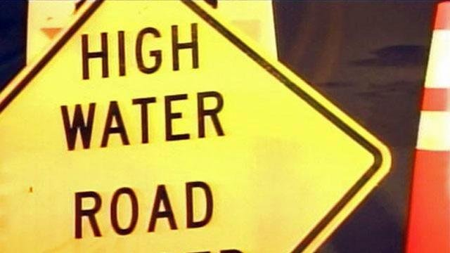 A sign warns drivers of potential flooding. (File/FOX Carolina)