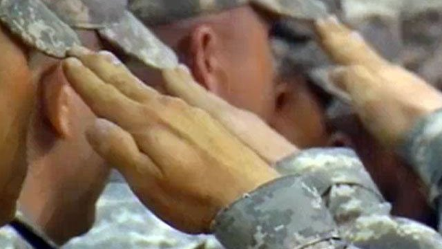 National Guard troops salute during a homecoming ceremony. (File/FOX Carolina)