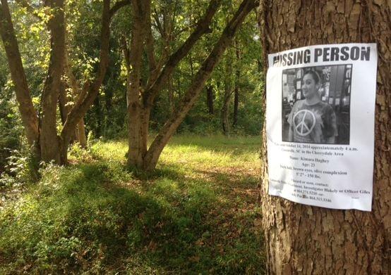 'Missing' poster at Swamp Rabbit trail head (FOX Carolina)