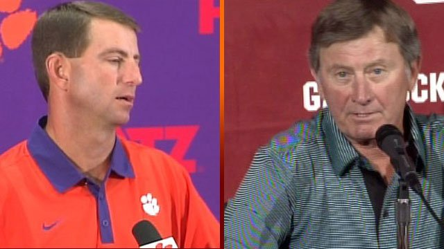 Clemson Head Football Coach Dabo Swinney (left) and South Carolina Head Football Coach Steve Spurrier. (File/FOX Carolina)