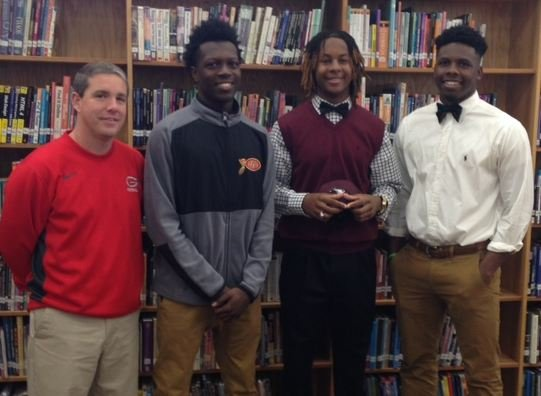 Greenville High School football players prepare to sign commitment letters (FOX Carolina)