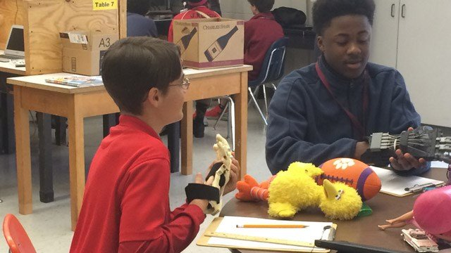 Students will work together to create 3-D printed mechanical hands. (Feb. 13, 2015/FOX Carolina)