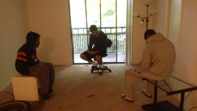 Leandro Linares (center) and two other players sit in their empty living room. (Oct. 18, 2013/FOX Carolina)
