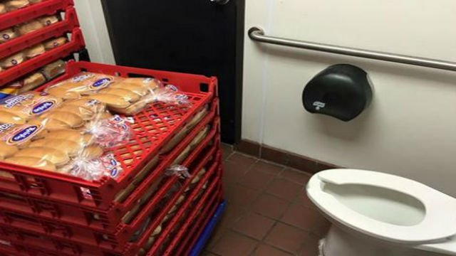 Photo of food being stored in restaurant bathroom going for Food to go to the bathroom