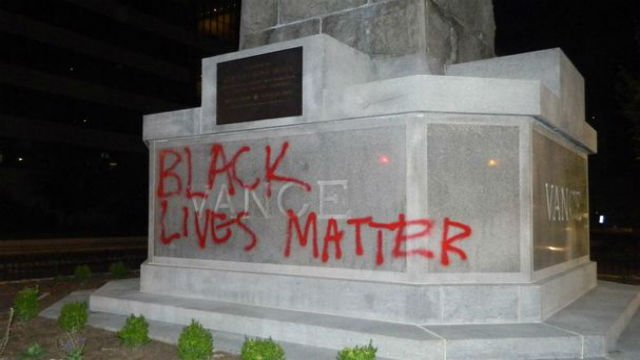 Message spray painted on Vance Monument (Courtesy: Asheville police)
