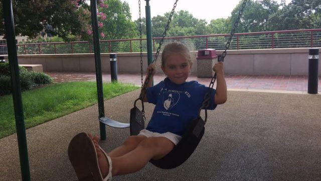 4-year-old Liliana Eargle swinging at playground. (FOX Carolina/ July 29, 2015)