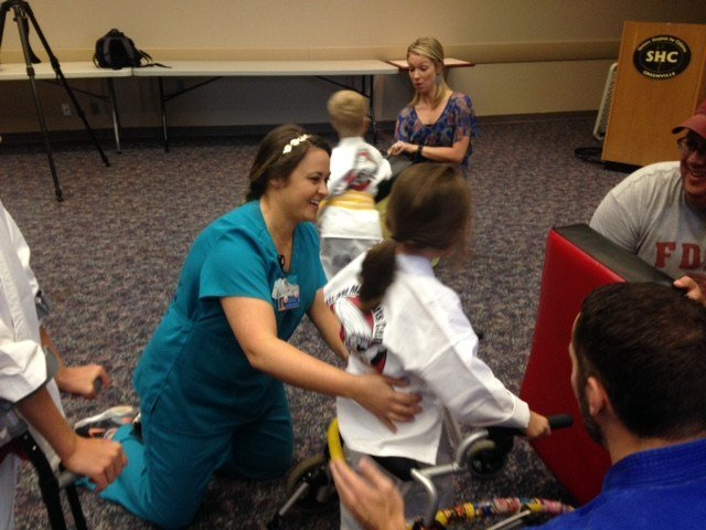 Physical therapist Chelsie Reed with student Ellie, during a karate class at Shriners Hospital (FOX Carolina)