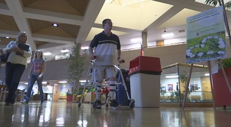 Dillon Greenway walks through the halls of Shriners Hospital in Greenville