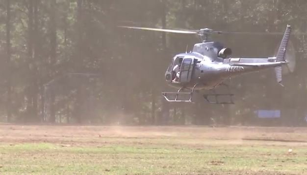 Helicopter drying Clemson grass lot (Courtesy: Clemson Athletic Dept.).