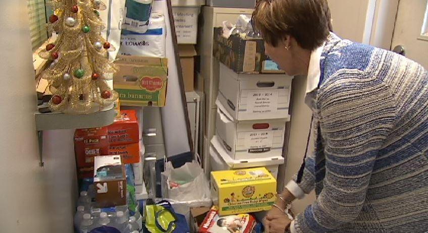Mayor Lisa Scott looks over donations to the city of Kingstree (Fox Carolina)