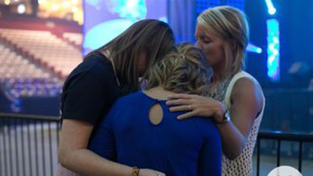 Amanda Blackburn, far right, is pictured in prayer at the Unify Greenville revival last August. (Photo provided by Unify Greenville)