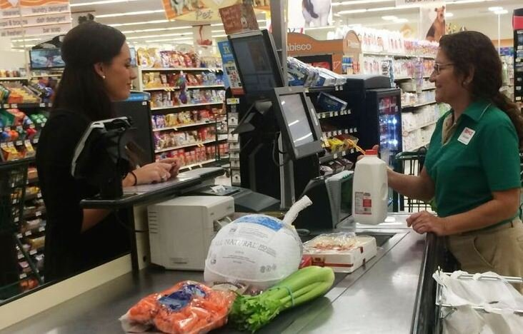 A customer purchases a turkey and items at Bi-Lo (Courtesy: Bi-Lo)