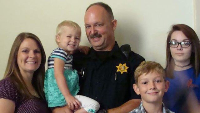 Dave Dempsey is shown in this provided picture surrounded by his family.