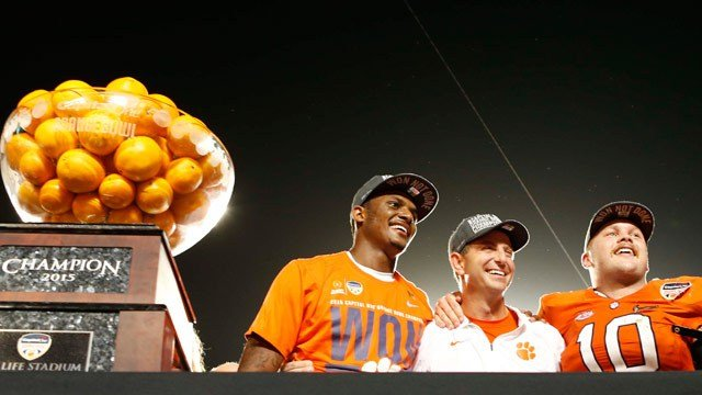 Clemson coach Dabo Swinney is flanked by Deshaun Watson and Ben Boulware after they won their Orange Bowl win (AP).