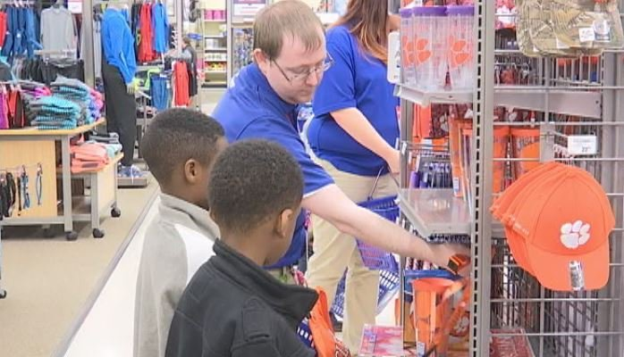Kids from the Boys and Girls Club receive Clemson gear from Academy Sports. (Source: Fox Carolina)