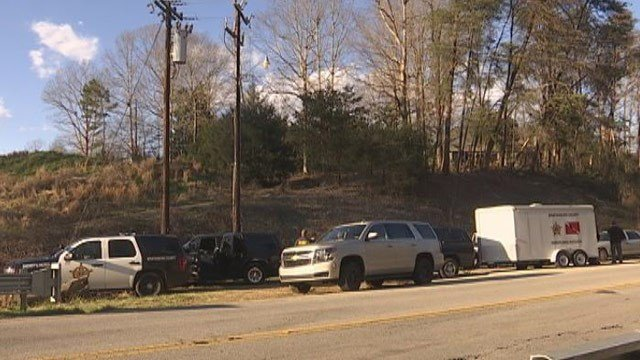 Deputies searched the Tyger River Tuesday for clues in the brutal shooting of a mother. (FOX Carolina 1/12/2016)