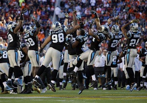 The Carolina Panthers jump on the field before the NFL Super Bowl 50 football game Sunday, Feb. 7, 2016, in Santa Clara, Calif. (AP Photo/Ben Margot)