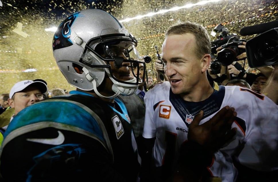 Carolina Panthers' Cam Newton (1) talks to Denver Broncos' Peyton Manning (18) after the NFL Super Bowl 50 football game Sunday, Feb. 7, 2016, in Santa Clara, Calif. The Broncos won 24-10. (AP Photo/David J. Phillip)