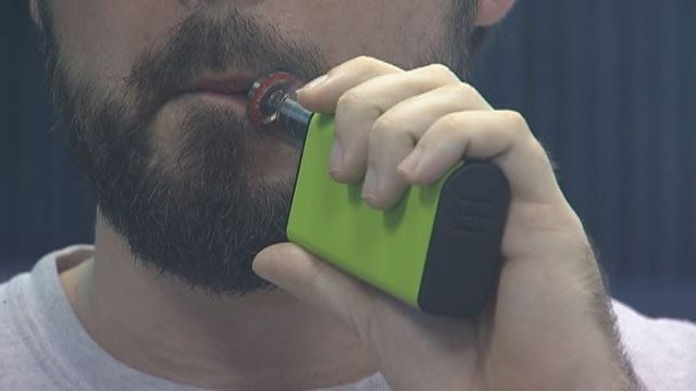 A man vapes from an e-cigarette (FOX Carolina)